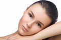 Beautiful woman face close up portrait studio on white. head on hand, looking at camera, spa, fresh clean skin