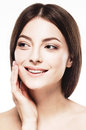 Beautiful woman face close up portrait touching her cheek by palm isolated on white Royalty Free Stock Photo