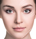 Beautiful woman face with correction lines. Royalty Free Stock Photo