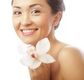 Beautiful woman face with orchid flower portrait close up of model is a asian beauty Royalty Free Stock Photos