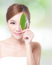 Beautiful woman face portrait with green leaf Royalty Free Stock Photo