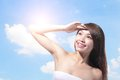 Beautiful woman face with sunshine and sky blue concept for skin care sun block asian beauty Royalty Free Stock Photo
