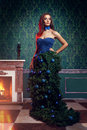 Beautiful woman in fantasy christmas tree dress in rich vintage interior dream fashion concept beauty and Stock Photo