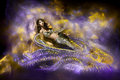 Beautiful woman in fantasy snake stylish dress. Stock Images
