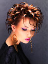 Beautiful woman with fashion hairstyle and pink makeup bright posing at studio Stock Images