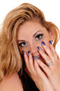 Beautiful woman with finger on face. Royalty Free Stock Photo