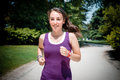 Beautiful woman fitness running at the park Stock Images