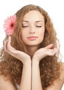 Beautiful woman with flower in her hair Stock Images