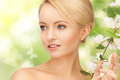 Beautiful woman with flowers on twig Royalty Free Stock Photos