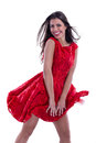Beautiful woman in fluttering dress laugh Stock Image