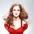 Beautiful woman with flying hair in red portrait pretty model long Royalty Free Stock Photos