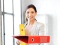 Beautiful woman with folder bright picture of Stock Photo