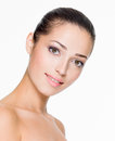Beautiful woman with fresh skin of face closeup portrait isolated on white Royalty Free Stock Photography