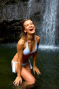 Beautiful Woman in Front of Waterfall Stock Photography