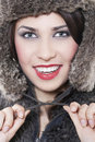 Beautiful woman in a fur coat Stock Photography