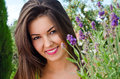 Beautiful woman in the garden with flowers girl smiling near a bouquet of lavender on a hot summer day Royalty Free Stock Images