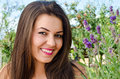 Beautiful woman in the garden with flowers girl smiling near a bouquet of lavender on a hot summer day Stock Photography