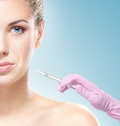 Beautiful woman gets an injection in her face close up portrait of young and healthy ready for a botox Royalty Free Stock Photos