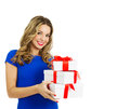 Beautiful woman with gift boxes happy blond hairstyle and make up holding stack of and smiling valentines day studio shot isolated Royalty Free Stock Photos