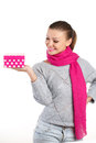 Beautiful woman a gift from a loved one for the holiday portrait of young in pink scarf with pink lipstick holding pink box in Stock Image