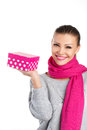 Beautiful woman a gift from a loved one for the holiday portrait of young in pink scarf with pink lipstick holding pink box in Royalty Free Stock Photos