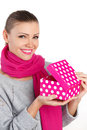 Beautiful woman a gift from a loved one for the holiday portrait of young in pink scarf with pink lipstick holding pink box in Royalty Free Stock Photo