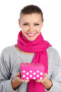 Beautiful woman a gift from a loved one for the holiday portrait of young in pink scarf with pink lipstick holding pink box in Royalty Free Stock Image