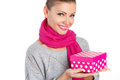 Beautiful woman a gift from a loved one for the holiday portrait of young in pink scarf with pink lipstick holding pink box in Royalty Free Stock Photography