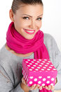 Beautiful woman a gift from a loved one for the holiday portrait of young in pink scarf with pink lipstick holding pink box in Royalty Free Stock Images