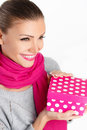 Beautiful woman a gift from a loved one for the holiday portrait of young in pink scarf with pink lipstick holding pink box in Stock Photos