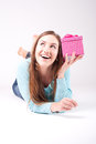 Beautiful woman with the gift wonders what is inside Royalty Free Stock Photos