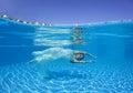 Beautiful woman girl white dress underwater diving swim blue sunny day pool Royalty Free Stock Photo