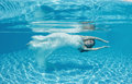 Beautiful woman girl white dress underwater diving swim blue sunny day pool Royalty Free Stock Photo