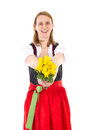 Beautiful woman giving bunch of roses in dirndl Royalty Free Stock Photo