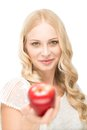 Beautiful woman giving red apple Stock Photos