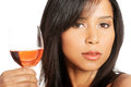 Beautiful woman with glass of rose wine portrait young happy Stock Photos