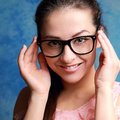 Beautiful woman in glasses looking happy Stock Photo