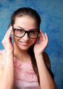Beautiful woman in glasses looking happy Stock Images