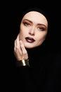 Beautiful woman in golden bracelet.woman face like a mask.beauty make-up Royalty Free Stock Photo