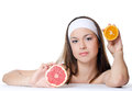 The beautiful woman with a grapefruit