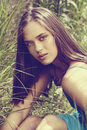 Beautiful woman in grass Stock Photos