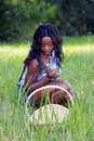 Beautiful Woman in Grassy Field with a Basket (3) Royalty Free Stock Photo
