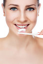 Beautiful woman with a great smile holding toothbrush isolated Stock Photos