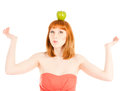 Beautiful woman with green apple on her head isolated white Royalty Free Stock Photos