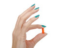 Beautiful woman hand and orange pill Royalty Free Stock Photo