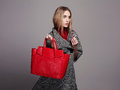 Beautiful woman with handbag beauty fashion girl in topcoat winter shopping portrait of Royalty Free Stock Photography