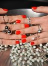Beautiful woman hands with red pattern polish manicured nails food pearl Royalty Free Stock Photo