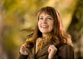 Beautiful woman the happiness mature horizontal portrait outdoor in park autumnal day Stock Photography