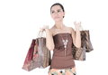 Beautiful woman happy holding shopping bags isolated on white background Royalty Free Stock Images
