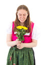 Beautiful woman happy about these roses in dirndl Royalty Free Stock Image